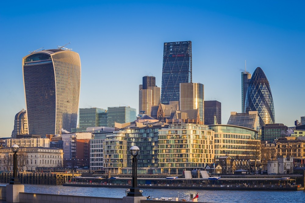 London, England – Bank. The world famous business district of London with skyscrapers and clear blue sky