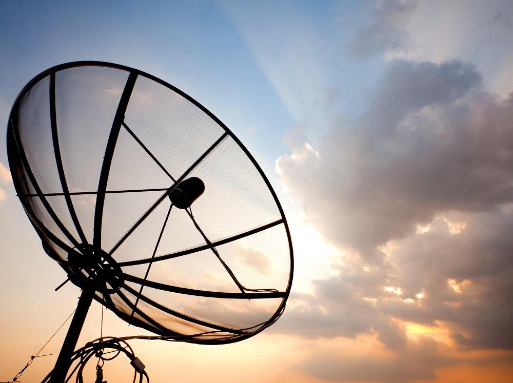 satellite dish over sunset sky