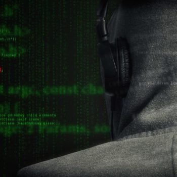 hooded anonymous computer hacker