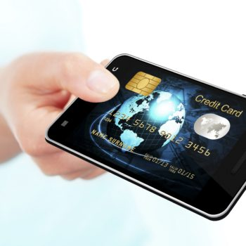 hand holding mobile phone with credit card screen