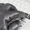 Hacking China concept with hand wearing black leather glove pres