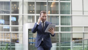 Businessman using a digital tablet and mobile phone