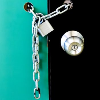 Padlock and chain locked – Security concept