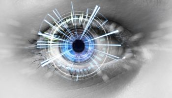 Eye of a woman with digital interface in front of it