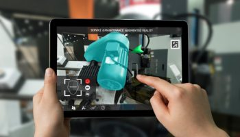 Industrial 4.0 , Augmented reality concept. Hand holding tablet with AR service , maintenance application and calling technician for check destroy part of smart machine motor in smart factory