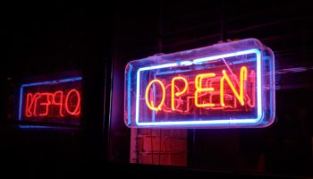 neon open sign welcomes customers into the restaurant