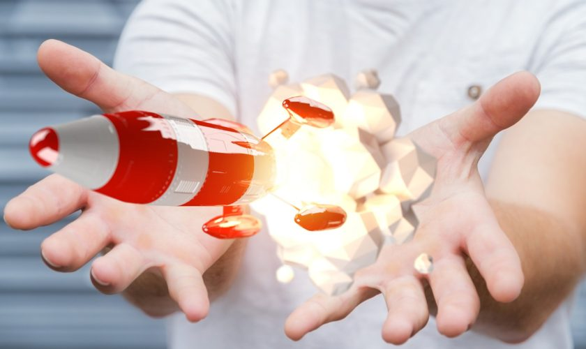Businessman holding red rocket in his hand 3D rendering