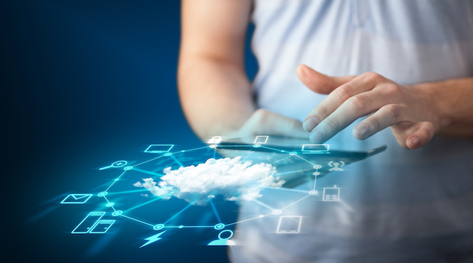 Close up of hand holding tablet with cloud network technology