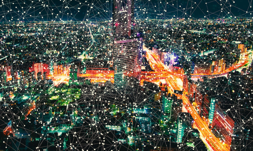 Aerial view of a massive highway intersection at night in Tokyo, Japan