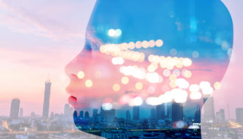 Internet of things Disruption everything , Digital transformation trend , artificial intelligence concept. 3d rendering of robot face ,bokeh and building twilight sunset of city abstract background.