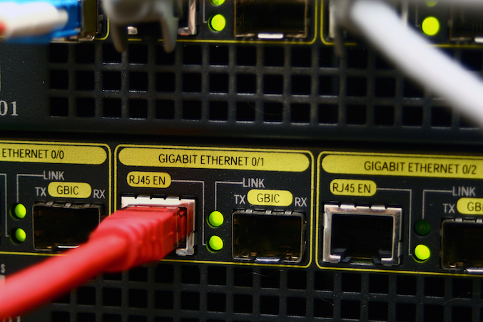 Red ethernet cable connected at gigabit speed