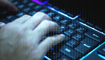 Cyber, Men's hand on the keyboard who are hacking the security system.