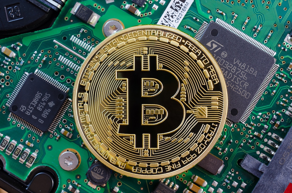 Concept of Bitcoin like a computer chip on motherboard