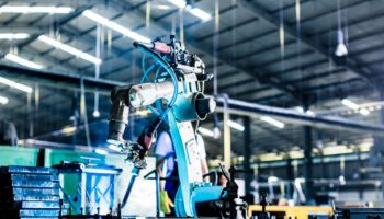 Welding robot in production plant or factory
