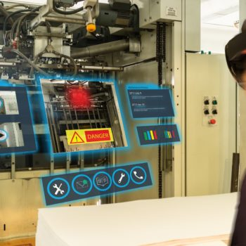 iot smart industry 4.0 concept. Industrial engineer(blurred) using smart glasses with augmented mixed virtual reality technology to read the data that  how to fix or maintenance the machine in factory
