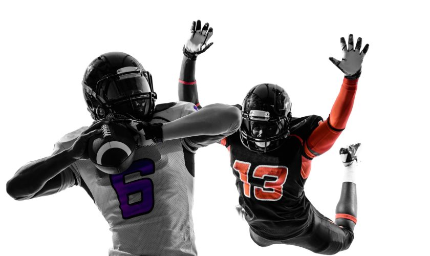 two american football players quarterback sacked in silhouette s