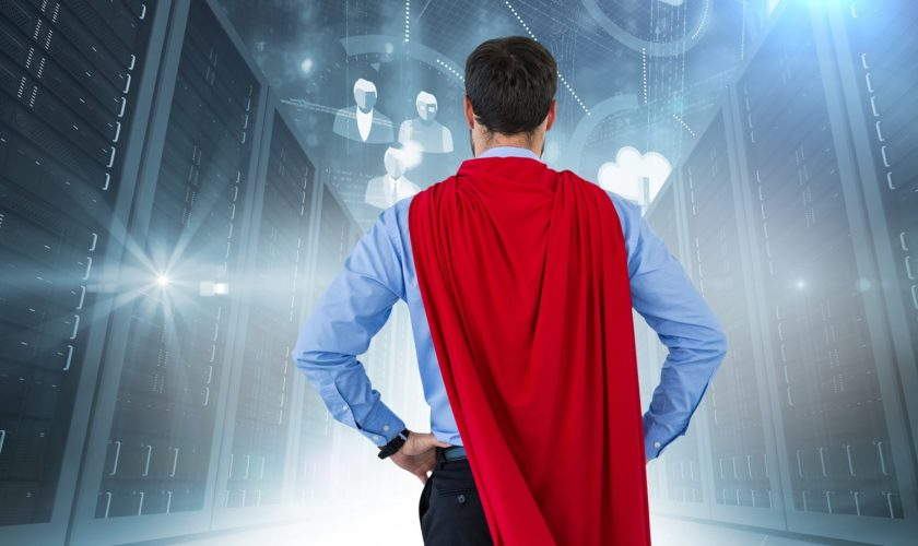 Digital composite of Back of business man superhero with hands o