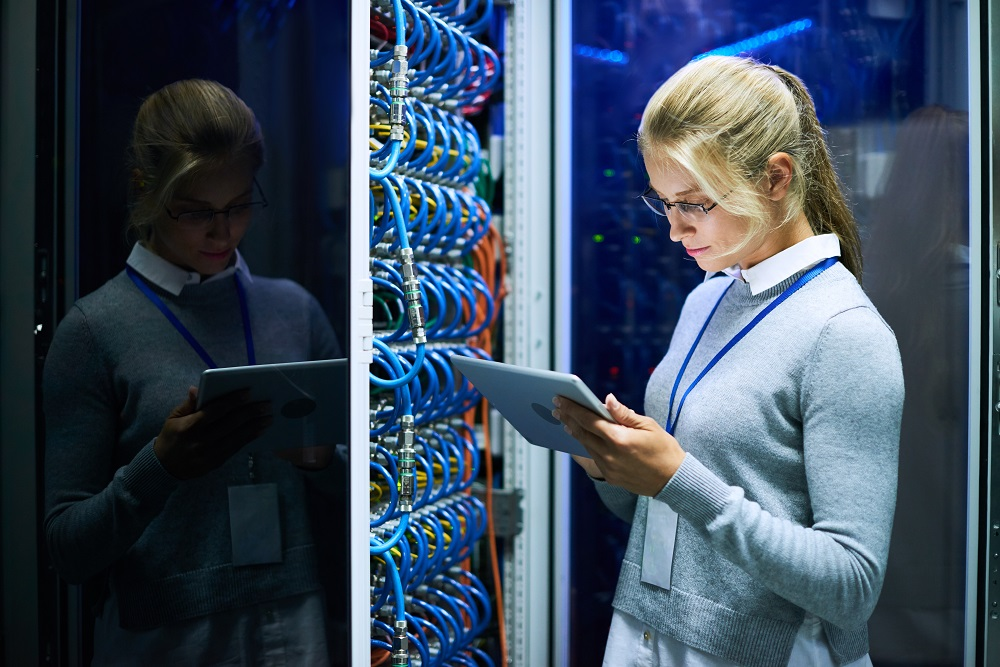 Young Woman Working with Supercomputer