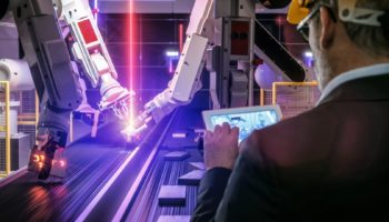 Smart automation industry robot in action welding metall while engineer uses his remote control table pc- industry 4.0 concept – 3D rendering