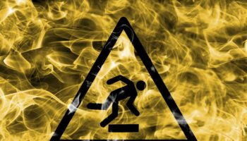 Risk Of Stumbling Hazard Warning Smoke Sign. Triangular Warning