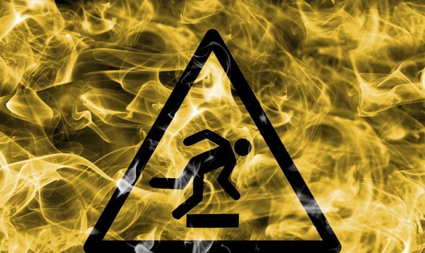 Risk Of Stumbling Hazard Warning Smoke Sign. Triangular Warning