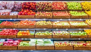 Fresh fruits and vegetables on shelf in supermarket