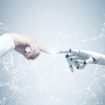 Human and robot hands reaching out, network